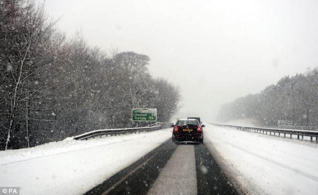 Snow carpets Britain as temperatures plunge to -7C and BLIZZARDS cause chaos