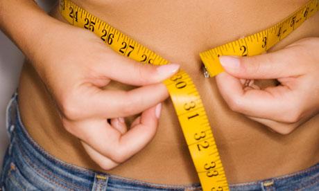 Woman's waist being measured