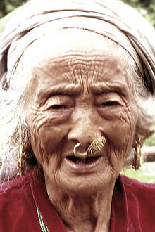 220px-Elderly_Limbu_woman_with_nose_piercing_(Nepal,_2006)