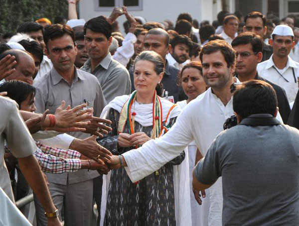 Congress supporters congratulate party president Sonia Gandhi and vicepresident general secretary Rahul Gandhi at her residence over the party's victory in the Karnataka Assembly elections, in New Delhi on Thursday