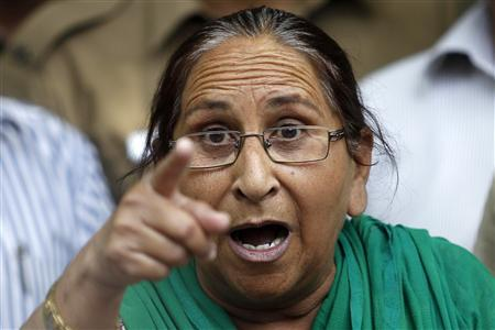 Dalbir Kaur, sister of Sarabjit Singh, gestures while speaking with the media in New Delhi
