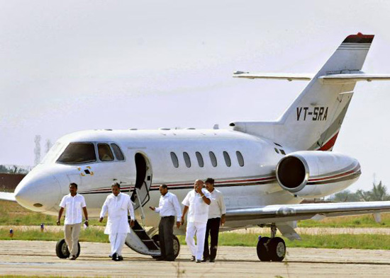 Chief Minister Siddaramaiah arriving at the Mysore airport on Friday