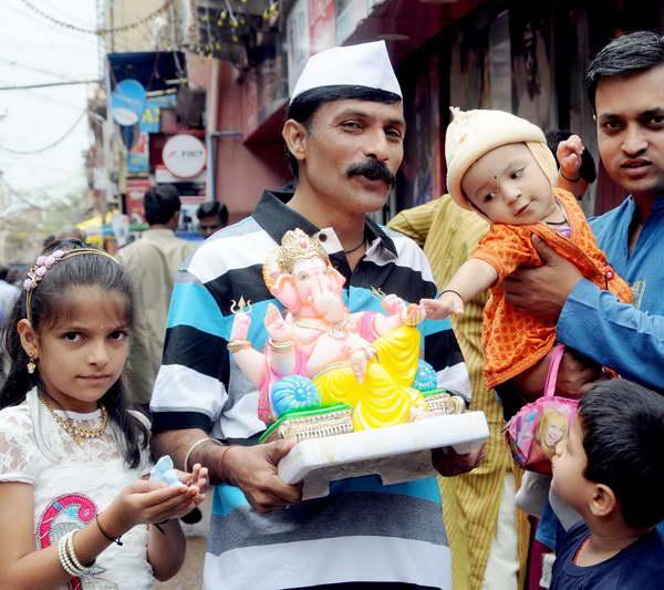 People celebrate Ganesha chaturthi  in Belgaum on Monday-KPN