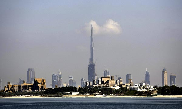 Burj Dubai (C) dwarfs the city skyline o
