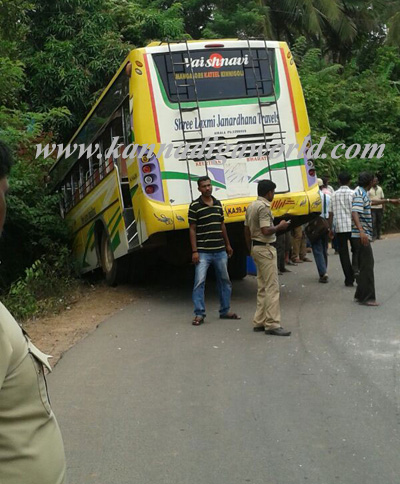Private bus hits crams into car, luckily escaping the drivers