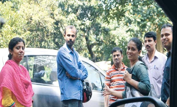 Some parents who gathered outside Orchids International School in Bengaluru on Sunday