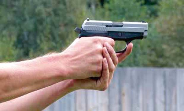 STOCK-FOOTAGE-MAN-SHOOTING-WITH-PISTOL