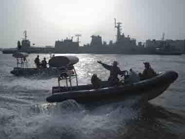Pakistan Navy personnel keep guard near the Navy ship PNS Zulfiqar after it returned to Karachi Pakistan