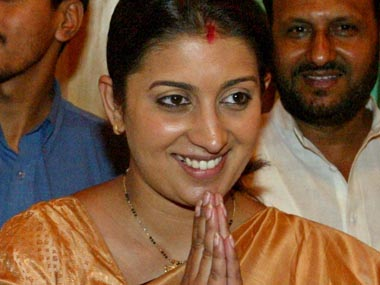 """SMRITI IRANI GREETS MEDIA BY CLASPING HER HANDS IN A """"NAMASTE"""" IN NEW DELHI."""