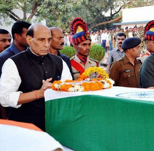 Home Minister Rajnath Singh pays his last respects to the deceased CRPF personnel