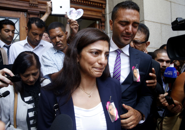 Ami Denborg, sister of Anni Dewani, leaves a court with family members in Cape Town