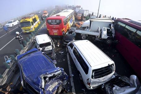 Damaged vehicles are seen on Yeongjong Bridge in Incheon