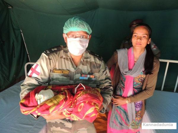 604kathmandu-an-army-official-with-the-baby-girl-kannadadunia