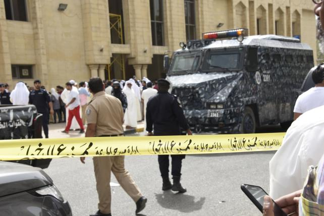 Police cordon off the Imam Sadiq Mosque after a bomb explosion following Friday prayers, in the Al Sawaber area of Kuwait City