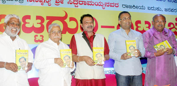 "President of Kannda Pusthaka Pradhikara Dr.Banjagere Jayaprakash releases the Book on CM Siddaramaiah  "" Ittaguri - dhitta Hejje"" at Gandhi Bhavan in Bengaluru on Sunday. Chandrashekara Kambara, Minister Dinesh Gundurao,and others are seen. - KPN ###  Book on CM Siddaramaiah"
