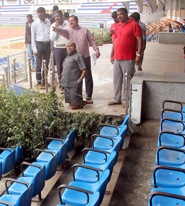 State Commissioner for Persons with Disabilities KS Ramanna examining the disorder at Kanteerava Indoor Stadium in Bengaluru on Tuesday Nov 17 2015 - KPN ### Inspection at Kanteerava Indoor Stadium