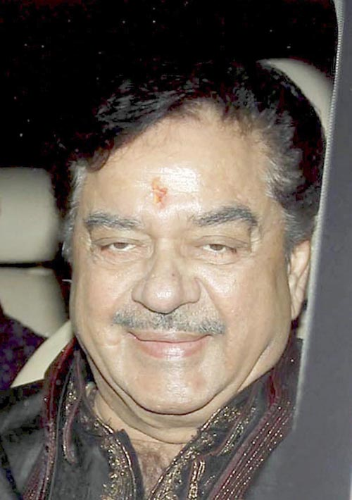 Mumbai : Bollywood actor and politician Shatrughan Sinha with son Luv arrives to attend Amitabh Bachchan's Diwali party, in Mumbai n Wednesday. PTI Photo (PTI11_12_2015_000064B)