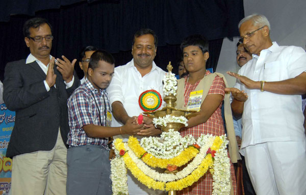 """Minister UT Khader with physically challenged children inaugurating the """"Spandana 2015"""" program of physically challenged children at Shikshakara Sadan, in Bengaluru on Thursday 19th November 2015 Pics: www.pics4news.com"""