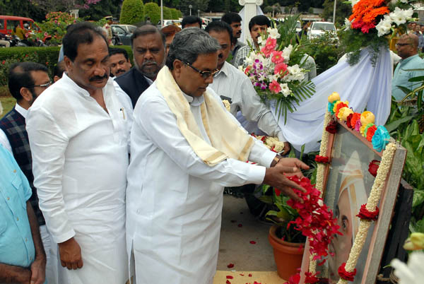 CM Siddaramaiah along with Ministers K J George and H Anjaneya offers floral tribute to Kengal Hanumanthaiah's portrait on occasion of the 35th Death Anniversary commemoration of Kengal Hanumanthaiah at Vidhana Soudha in Bengaluru on Tuesday Dec 01 2015 - KPN ### Kengal Hanumanthaiah35th Death Anniversary commemoration