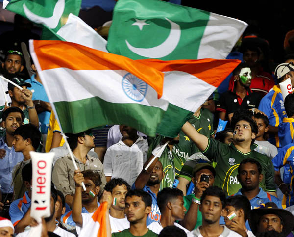 Indian and Pakistan cricket fans wave their national flags during an ICC Twenty20 Cricket World Cup Super Eight match between the two countries in Colombo, Sri Lanka, Sunday, Sept. 30, 2012. (AP Photo/Eranga Jayawardena)