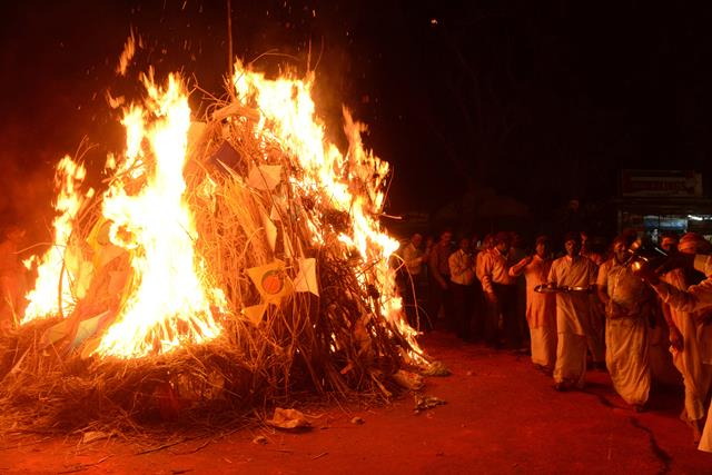 Hindu priests from Lord Jagannath Mandir participate in a ritual around the Holika bonfire outside the Lord Jagannath Mandir in Ahmedabad on March 26, 2013. The priests from Lord Jagannath Mandir and the police officers together ignited Holika which symbolizes the destruction of evil, to mark Holi. AFP PHOTO / Sam PANTHAKY (Photo credit should read SAM PANTHAKY/AFP/Getty Images)