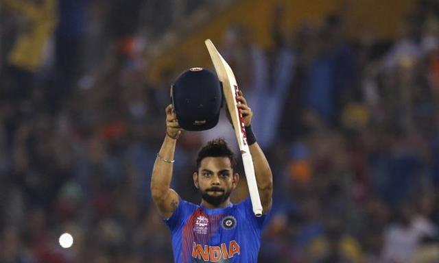 Cricket - India v Australia - World Twenty20 cricket tournament - Mohali, India - 27/03/2016. India's Virat Kohli acknowledges the crowd after winning their match. REUTERS/Adnan Abidi