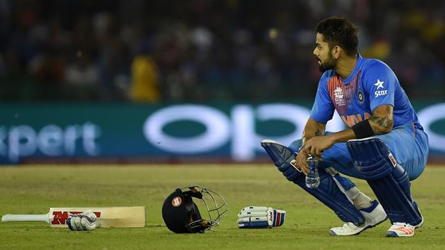 India's Virat Kohli drinks during a break in the World T20 cricket tournament match between India and Australia at The Punjab Cricket Stadium Association Stadium in Mohali on March 27, 2016. / AFP / MONEY SHARMA (Photo credit should read MONEY SHARMA/AFP/Getty Images)