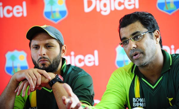 Pakistani captain Shahid Afridi (L) and coach Waqar Younis address a press conference during a training session at the Beausejour Cricket Ground in Gros Islet, St Lucia, April 20, 2011. The West Indies and Pakistan will play one Twenty 20 match, five ODIs and two test starting April 21, 2011. AFP PHOTO/Emmanuel Dunand (Photo credit should read EMMANUEL DUNAND/AFP/Getty Images)