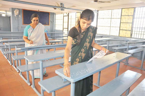 TEACHER ARE WRITTING THE ALL TICKET NUMBERS FOR SSLC EXAM IN CITY