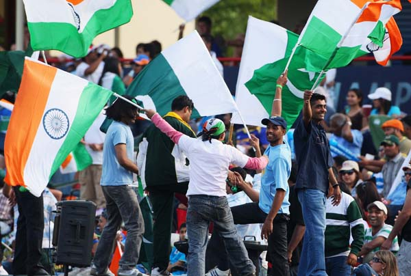 CENTURION, SOUTH AFRICA - SEPTEMBER 26:  Fans cheer on their team during the  ICC Champions Trophy group A match between India and Pakistan at Centurion on September 26, 2009 in Centurion, South Africa.  (Photo by Tom Shaw/Getty Images)