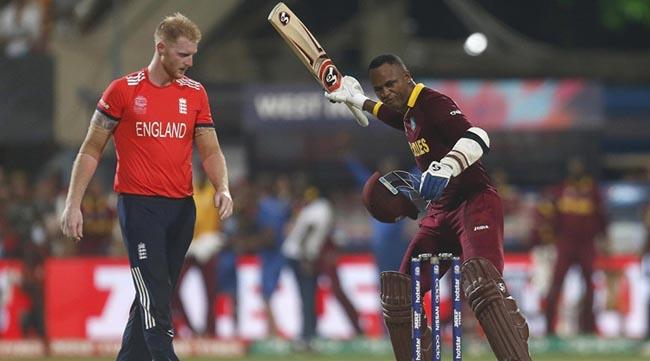 Cricket - England v West Indies - World Twenty20 cricket tournament final - Kolkata, India - 03/04/2016. West Indies Marlon Samuels (R) celebrates past England's Ben Stokes after winning the final.    REUTERS/Rupak De Chowdhuri