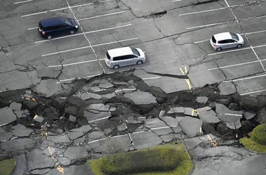 Cracks caused by an earthquake are seen in a parking lot in Minamiaso town, Kumamoto prefecture. REUTERS/Kyodo