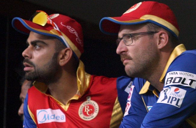 Bangaluru: Royal Challengers Bangalore captain Virat Kohli and RCB coach Daniel Vettori during an IPL-2015 match between Royal Challengers Bangalore and Kolkata Knight Riders at M Chinnaswamy Stadium in Bangaluru on May 2, 2015. (Photo: IANS)