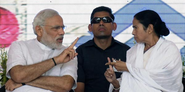 "ASANSOL, INDIA - MAY 10: Prime Minister Narendra Modi and Chief Minister Mamata Banerjee during the inauguration of '2.5 MT modernized & expanded IISCO Steel Plant' at Burnpur Polo Ground in the district Burdwan of West Bengal, on May 10, 2015 in Asansol, India. During the function, Modi described the Union Government and 29 State Governments as 30 pillars of ""TEAM INDIA"" which would take India forward. The upgraded steel plant of IISCO (Indian Iron and Steel Co) that has the country's largest blast furnace and has been modernised at a cost of Rs.16,000 crore. (Photo by Subhendu Ghosh/Hindustan Times via Getty Images)"