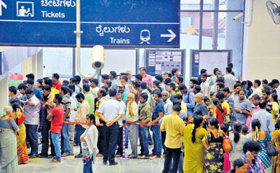 Public waiting for buying tickets for metro ride at Kempegowda station in Bengaluru on Sunday. Photo by B K Janardhan