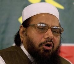 RAWALPINDI: Hafiz Mohammad Saeed, chief of Jamaat-ud-Dawwa and founder of Lashkar-e-Taiba, addresses a news conference in Rawalpindi, Pakistan on Wednesday, April 4, 2012. Saeed, one of Pakistan's most notorious extremists, mocked the United States during a defiant media conference close to the country's military headquarters, a day after the U.S. slapped a $10 million bounty on him. AP/PTI (AP4_4_2012_000159B)