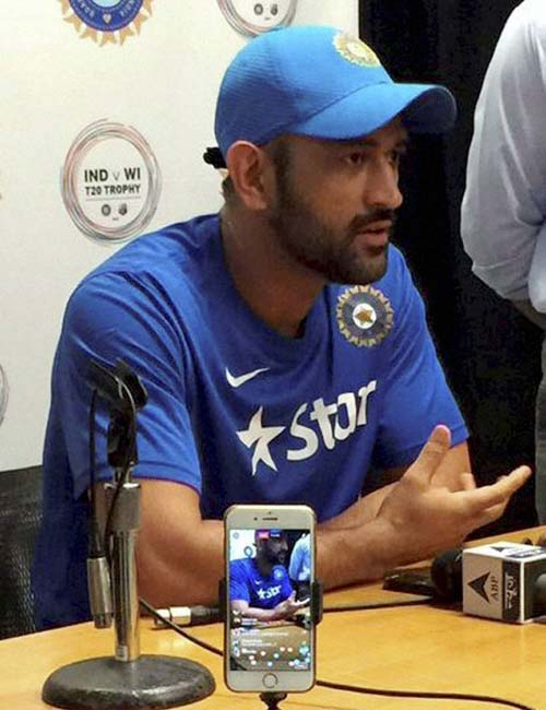 Florida: Skipper MS Dhoni addresses the media at Fort Lauderdale in Florida on Friday. Indian cricket team will be playing two T20 Internationals against West Indies for the first time in the United States. PTI Photo / Twitter  (PTI8_26_2016_000290B)