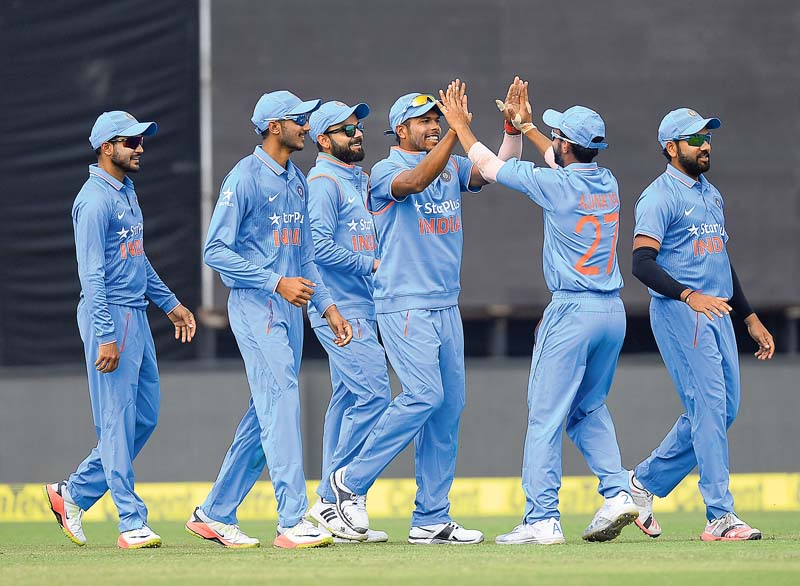 Indian team players celebrate after India's bowler Hardik Pandya dismissed New Zealand's batsman Luke Ronchi during the first one day international match between India and New Zealand at The Himachal Pradesh Cricket Association Stadium (HPCA) in Dharamsala on October 16, 2016.   / AFP PHOTO / SAJJAD HUSSAIN / ----IMAGE RESTRICTED TO EDITORIAL USE - STRICTLY NO COMMERCIAL USE----- / GETTYOUT