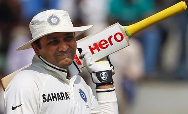 India's Virender Sehwag walks off the field after being dismissed by West Indies' Devendra Bishoo during the fifth day of their third and final test cricket match in Mumbai November 26, 2011. REUTERS/Vivek Prakash (INDIA - Tags: SPORT CRICKET)