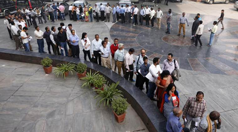 A large queue of people wait outside a bank to exchange Indian currency in the denominations of 1000 and 500 that have been declared to be of no value, in New Delhi, India, Friday, Nov. 11, 2016. Delivering one of India's biggest-ever economic upsets, Prime Minister Narendra Modi this week declared the bulk of Indian currency notes no longer held any value and told anyone holding those bills to take them to banks to deposit or exchange them. (AP Photo/Saurabh Das)