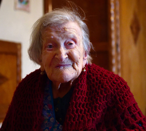 (FILES) This file photo taken on May 14, 2016 shows Emma Morano, 116, posing for AFP photographer in Verbania, North Italy. An alert and chatty Italian woman, Emma Morano, on November 29, 2016 celebrates her 117th birthday as the last known person alive who was born in the 19th century. Born November 29, 1899,  she is the world's oldest living person and the secret to her longevity appears to lie in eschewing usual medical wisdom.  / AFP PHOTO / OLIVIER MORIN