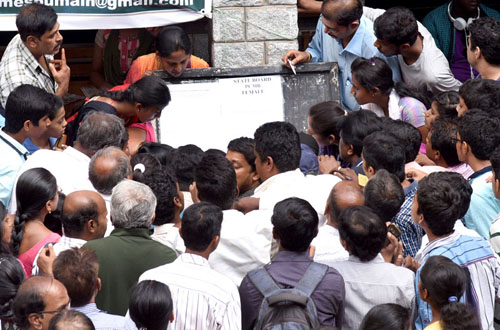 Students and their parents are anxiously looking in to the notice board, were PUC admission list displayed at MES College, Malleshwara in Bengaluru on Friday 3rd June 2016. Photo/ B H Shivakumar